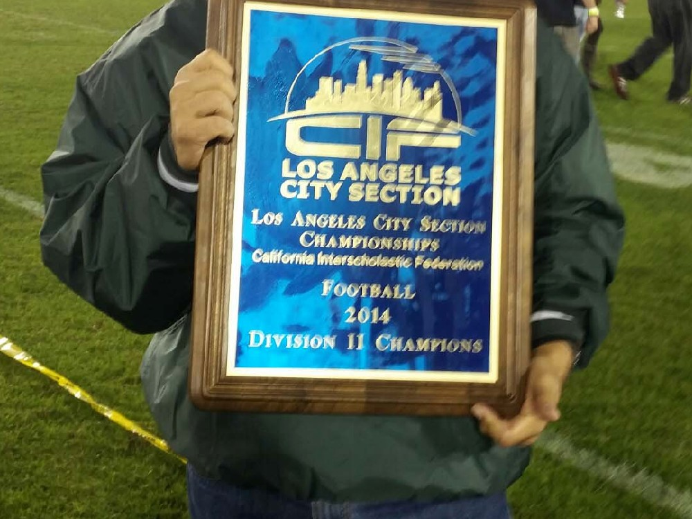 Garcia with 2014 Championship Plaque